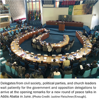 Delegates from civil society, political parties, and church leaders wait patiently for the government and opposition delegations to arrive at the opening remarks for a new round of peace talks in Addis Ababa in June.