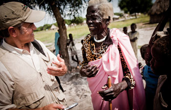 George Clooney in southern Sudan with an elderly woman. Photo by Enough Project/Tim Freccia.