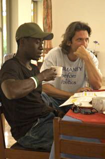 Don Cheadle and John Prendergast having coffee