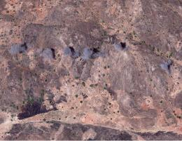 Satellite image of smoke plumes as evidence of bombardment in Toroge