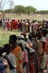 Sudanese wait in line to receive aid
