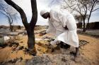 Attahi Mohammed Sigit, a resident of North Darfur, examines the destruction.
