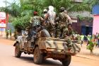 Rebel soldiers drive through the center of the capital Bangui in Central African