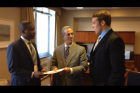 Student representatives Georges and Jake deliver the letter to U.S. Special Envo