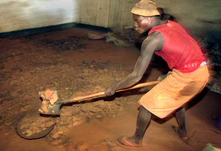A miner works in Congo